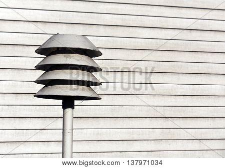 Gray Street Light Against Wooden Wall.