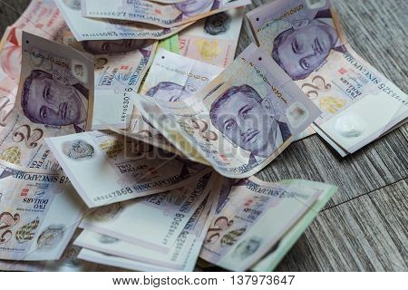 Singapore dollar SGD banknote on wood background poster
