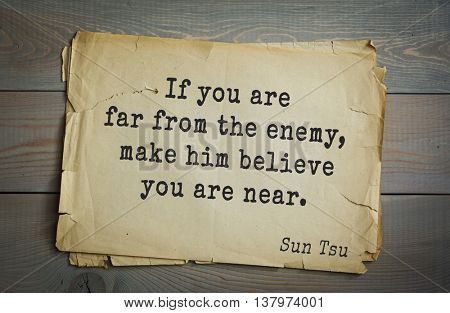 Ancient chinese strategist and philosopher Sun Tzu quote on old paper background. If you are far from the enemy, make him believe you are near.