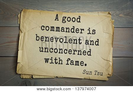 Ancient chinese strategist and philosopher Sun Tzu quote on old paper background. A good commander is benevolent and unconcerned with fame.