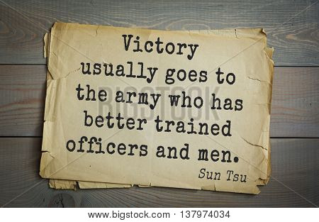Ancient chinese strategist and philosopher Sun Tzu quote on old paper background. Victory usually goes to the army who has better trained officers and men.