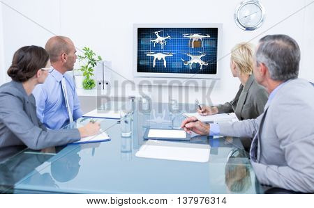 Business team looking at time clock against composite image of four drones