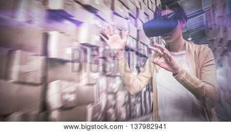 Businesswoman holding virtual glasses against forklift machine in warehouse