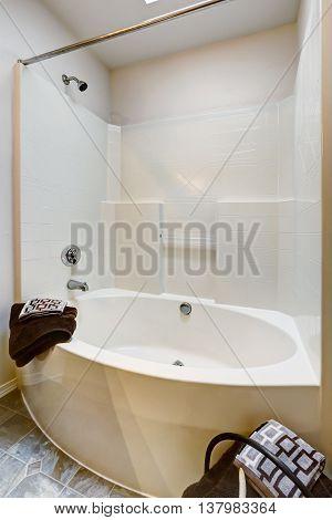 New Bathroom With Tile Floor And Bathtub.