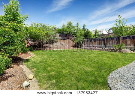 Spacious Backyard Area With Dark Brown Wooden Fence