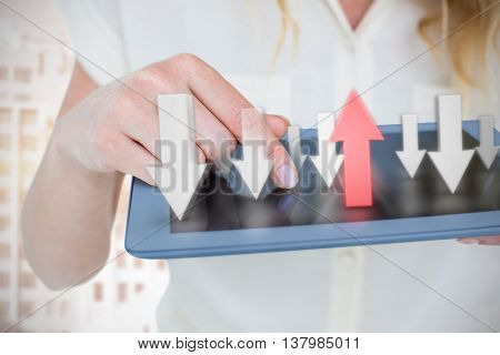 Woman using tablet pc against tall buildings with bright light