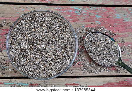 Bowl with chia seeds on rustic wooden table