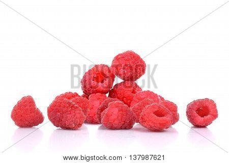 fresh organic raspberries isolated on white background