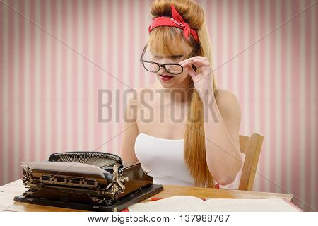 sexy young pinup girl with old typewriter