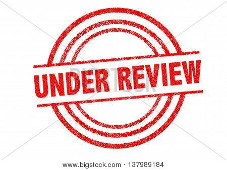 UNDER REVIEW Rubber Stamp over a white background. poster