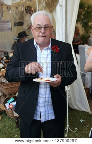 2ND JULY 2016,PORTSMOUTH,ENGLAND:  An overweight englishman eating food at a wedding in portsmouth,england, 2nd july 2016