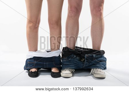 Romantic Legs And Shoes Of A Man And Woman With Clothes Down