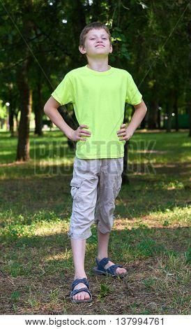 teenage boy portrait like a Superman posing on outdoor, summer season
