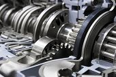 Gearbox cross-section, engine industry, sprockets, cogwheels and bearings of automotive transmission for oversize trucks, SUV, cargo, commercial and construction vehicles, selective focus poster