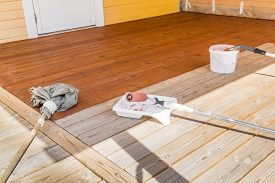 Painting The Porch With Pigmented Oil