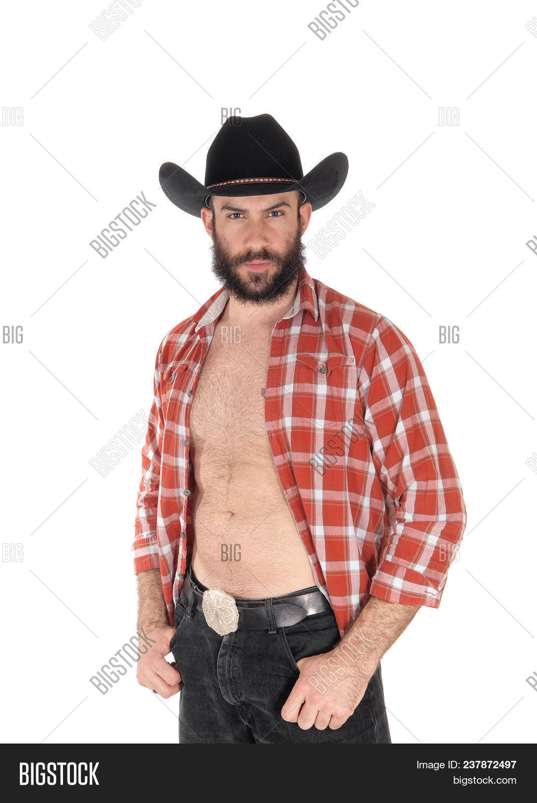 b627dee3d0 A close up image of a young man in a open checkered shirt wearing a cowboy  hat and black jeans