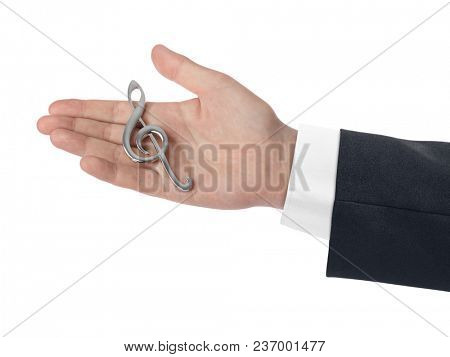 Hand holding a treble clef isolated on white background