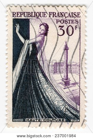 Leeds, England - April 20 2018: An Old Purple French Postage Stamp With An Image Of A Woman In A Dre