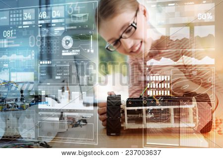 Touching Wires. Clever Talented Cheerful Schoolgirl Looking At The Modern Robot And Touching A Yello