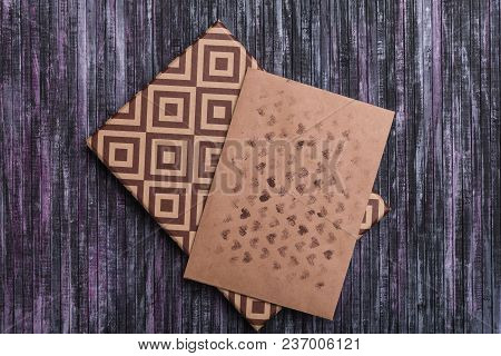 Envelope Of Kraft Paper. Love Letter Envelope. Wooden Background. A Holiday Gift Box. Gift With The