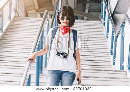 Woman Tourist Travel With A Camera Outdoor