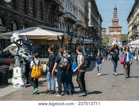 Milan, Italy - April 17, 2018: Street Performers Dressed Up As Transformers Characters Entertain Tou