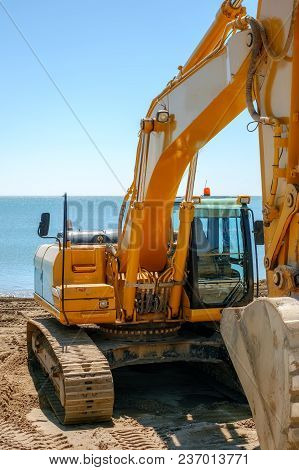 Yellow Excavator On The Beach, Close View