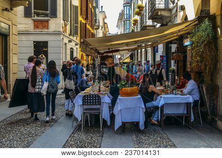 Milan, Italy - April 17, 2018: Tourists Strolling In Historic And Bohemian Brera