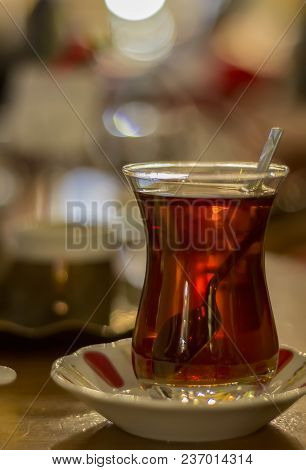 Hot Turkish Tea With Spoon Outdoors On The Table. Turkish Tea And Traditional Turkish Culture Concep