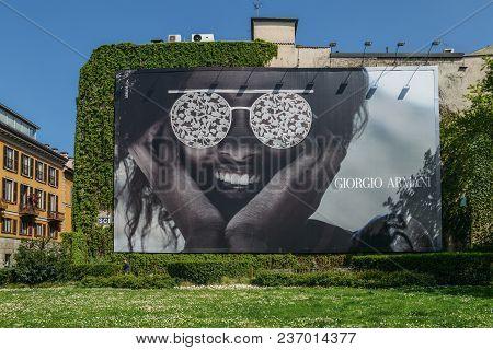 Milan, Italy - April 17, 2018: Illustrative Editorial Of Giant Giorgio Armani Advertimsement On Wall