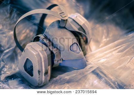 The Used Respirator Lies On The Cellophane. Toned