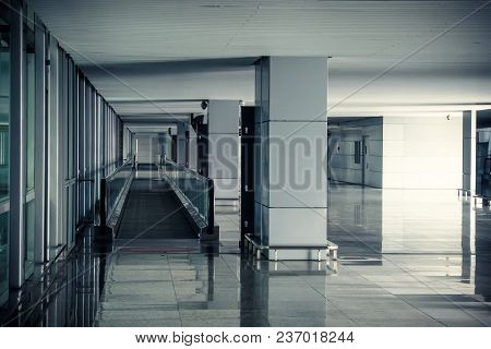 Modern Airport Hall Interior With Nobody. Empty Airport Premises Without People. Straight Escalator