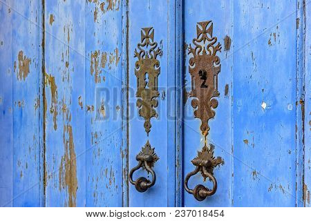 Old And Aged Historic Church Door In Blue Wood In The City Of Ouro Preto, Minas Gerais With Metal