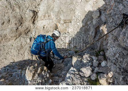 Mountaineer Climbing In Mouintains. Brenta Doloimtes, Sentiero Delle Bocchette Alte.