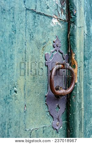 Old And Aged Historic Church Door In Blue-green Wood In The City Of Ouro Preto, Minas Gerais With A
