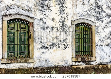 Old And Aged Historic Wooden Church Windows With Stone Frame And Grids In The City Of Ouro Preto, Mi