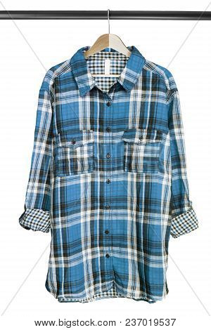 Blue Cotton Checkered Shirt Hanging On Wooden Clothes Rack Isolated Over White
