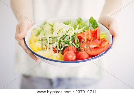 Closeup Shot Of Composed Chopped Vegetables In Bowl Topped With Green.