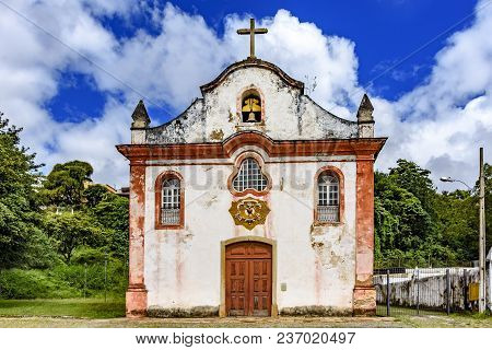 Aged Historical Church High In One Of The Several Mountains Of The City Of Ouro Preto With The Veget