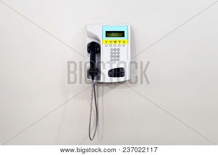 White Public Telephone Over White Background. Pay Phone With Credit Or Debit Card.