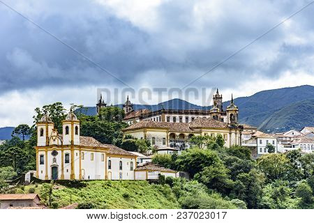 Ancient Historical Churches Among The Houses And Streets Of Ouro Preto City In Minas Gerais With Hil