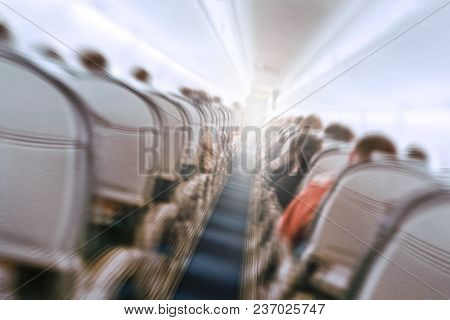 Aerophobias Concept. Plane Shakes During Turbulence Flying Air Hole. Blur Image Commercial Plane Mov