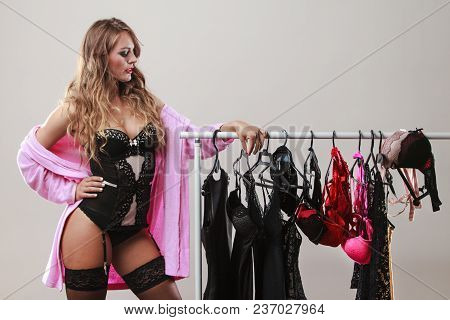 Sexy And Romantic Shopping. Gorgeous Sensual Long Haired Woman Buying Seductive Clothes Lingerie. Dy