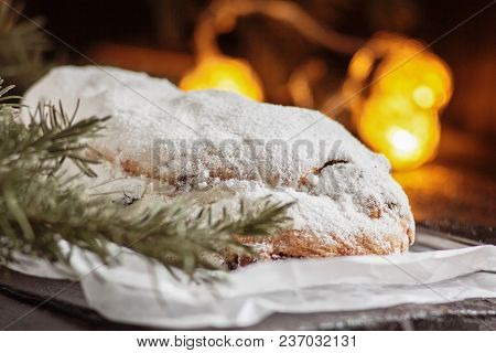 Dresden Stollen Is A Traditional German Cake With Raisins On A Light Knitted Background.gift For Chr