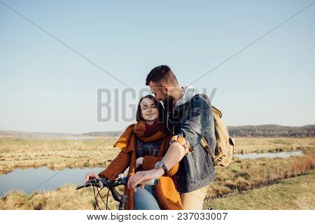 Couple In Love On A Bike On Nature In Autumn