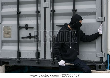 Mask Thief In Balaclava Holding A Knife In His Hand, Prepare To Attack Or Rob.