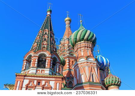 The Bell Tower And Dome Of St. Basil's Cathedral Against The Blue Sky On A Sunny Morning. Spring In
