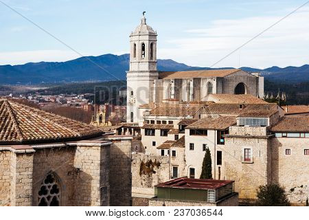 an aerial view of the Old Town of Girona, in Spain, seen from above highlighting the bell tower of the Cathedral
