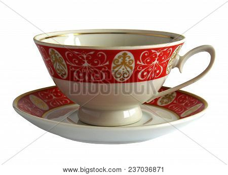 Antique Porcelain Cup And Saucer Isolated On White Background