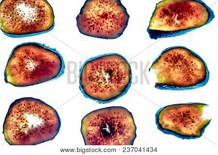 Thinly Sliced Fig Pieces On White Background